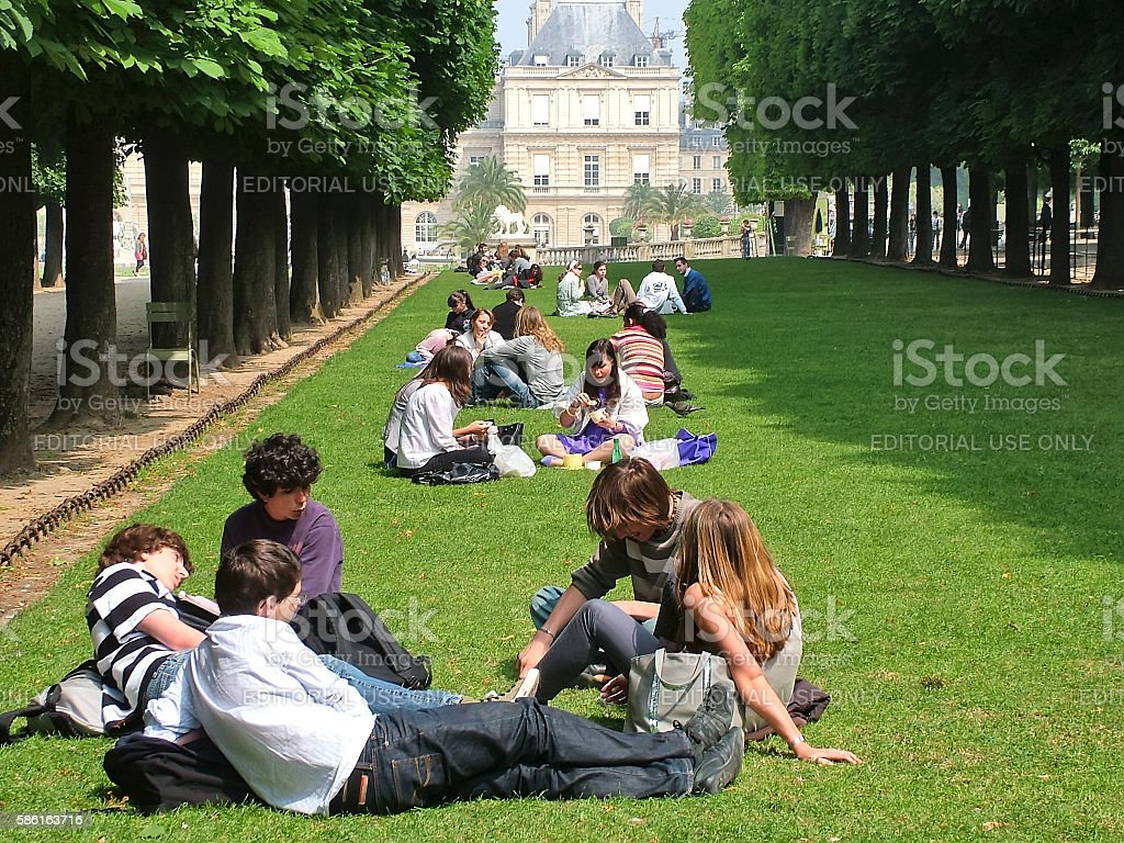 Rest on the grass in the Luxembourg Gardens in Paris stock photo