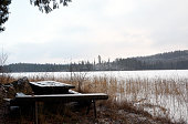 Rest place with furniture at the frozen lake shore