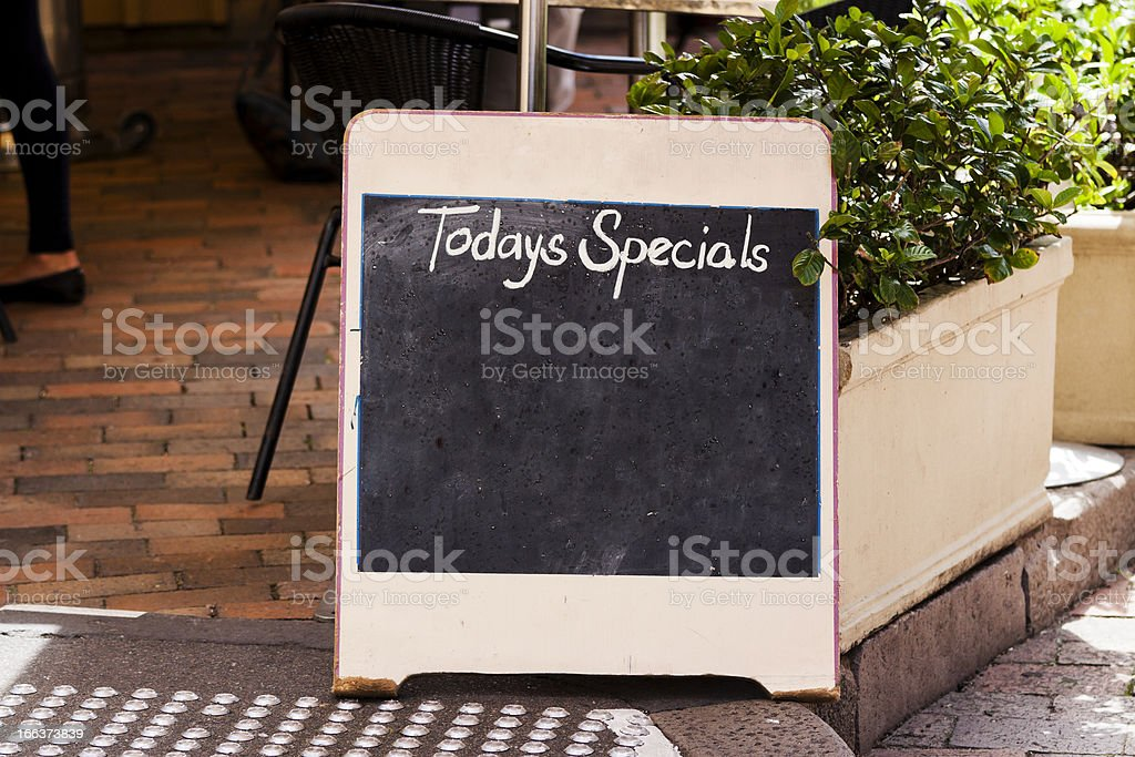 Restaurant blackboard sign 'Todays Specials' on footpath, copy space stock photo