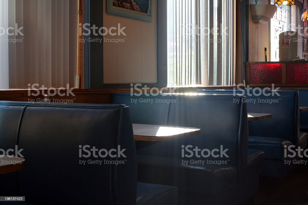 Restaurant Booth With Streaming Sunlight stock photo