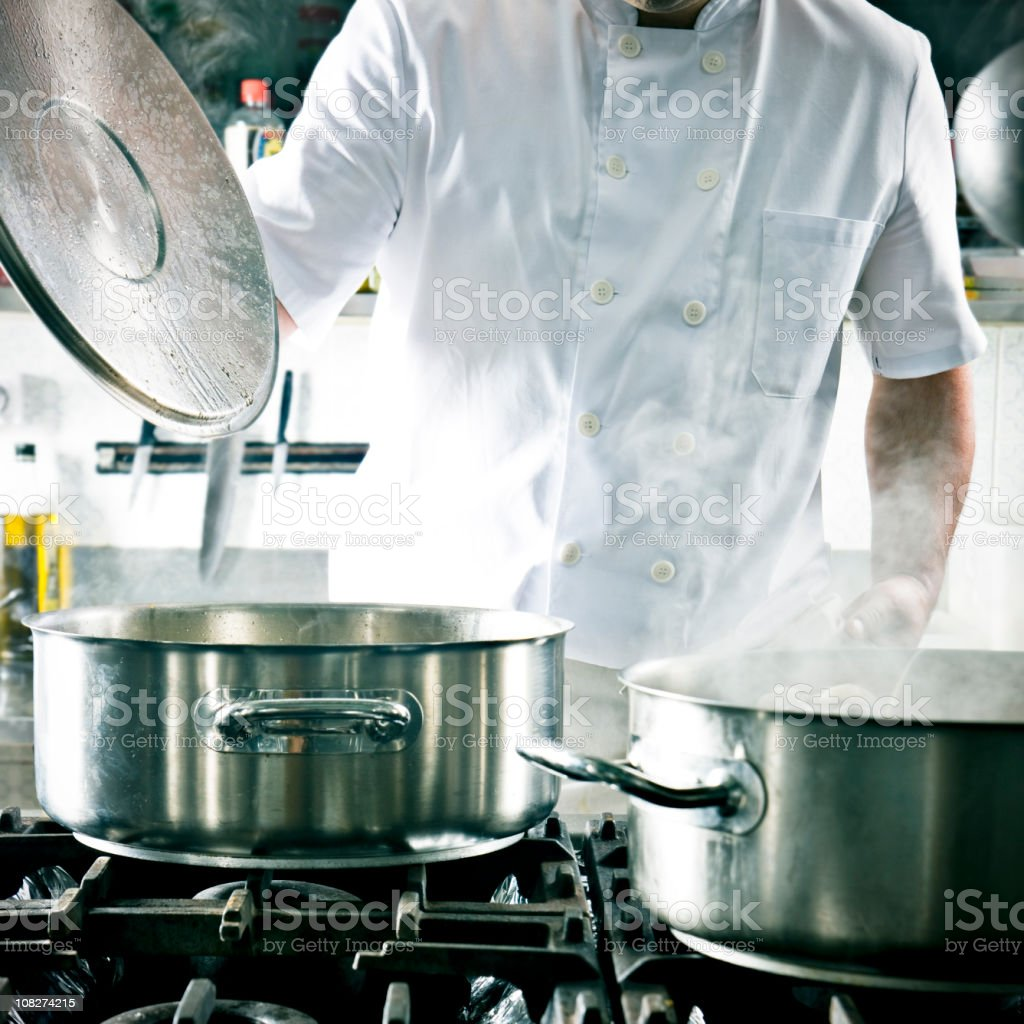 Restaurant Cook in Kitchen royalty-free stock photo