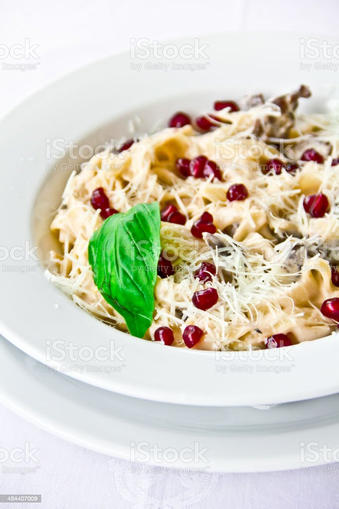 restaurant dish,pasta with pomegranate seeds royalty-free stock photo