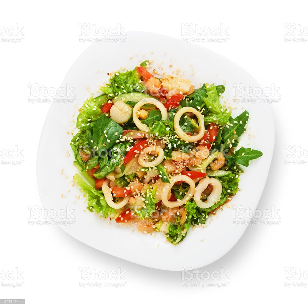 Restaurant food isolated - seafood salad with calamari rings stock photo