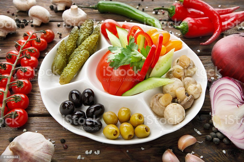 Restaurant food - pickled tomato and cucumber stock photo
