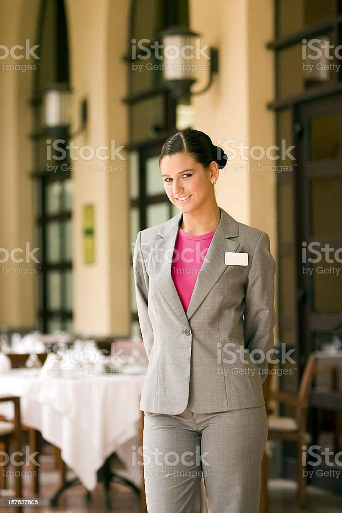 Restaurant hostess stock photo