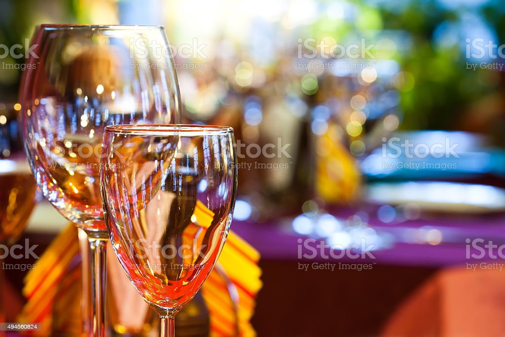 Restaurant interior with wine glasses, closeup stock photo