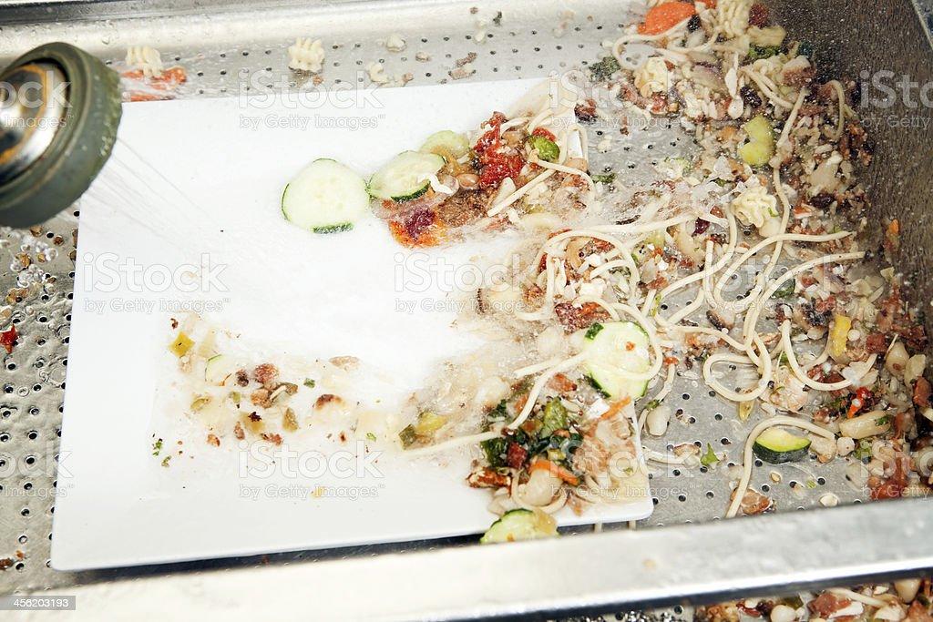 Restaurant Kitchen Dishwasher Prerinse Sprayer Washing Plate stock photo
