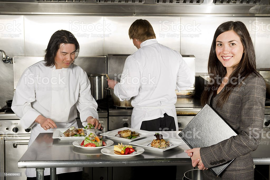 Restaurant manager at the kitchen royalty-free stock photo
