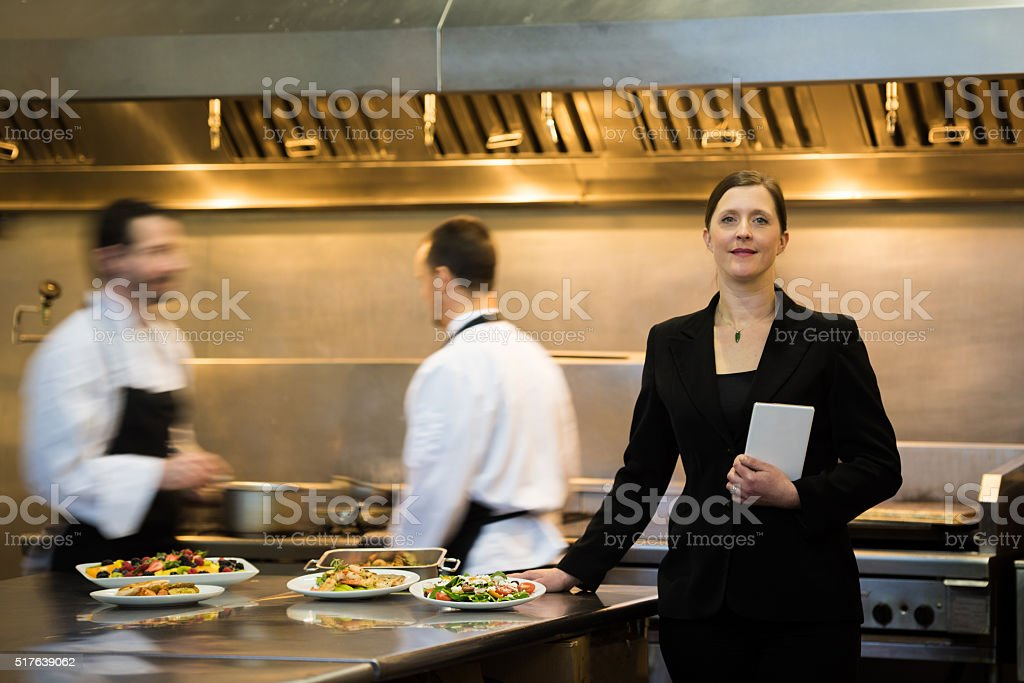Restaurant manager in a commercial kitchen stock photo