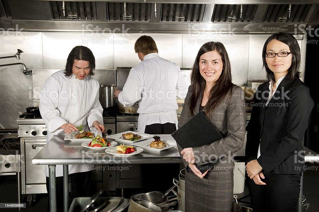 Restaurant manager with professional chefs working stock photo