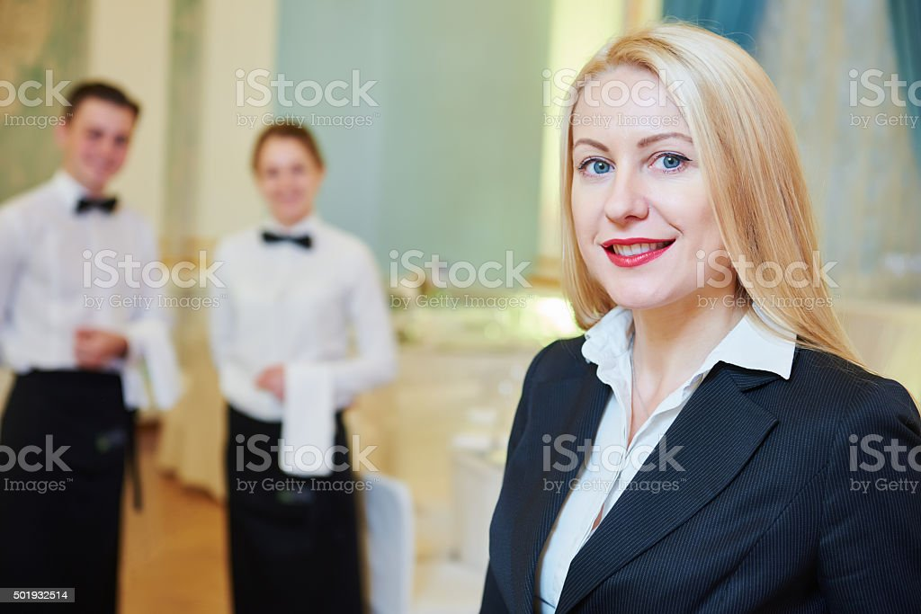 Restaurant manager with waitress and waiter stock photo