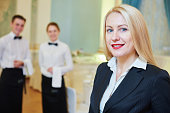 Restaurant manager with waitress and waiter