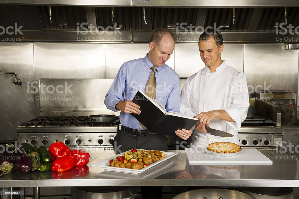 Restaurant manager working with a professional chef royalty-free stock photo