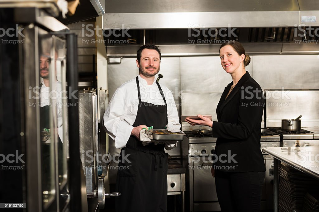 Restaurant manager working with a professional chef stock photo