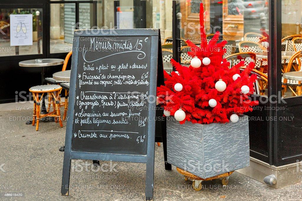 Restaurant menus and Christmas tree, Paris stock photo