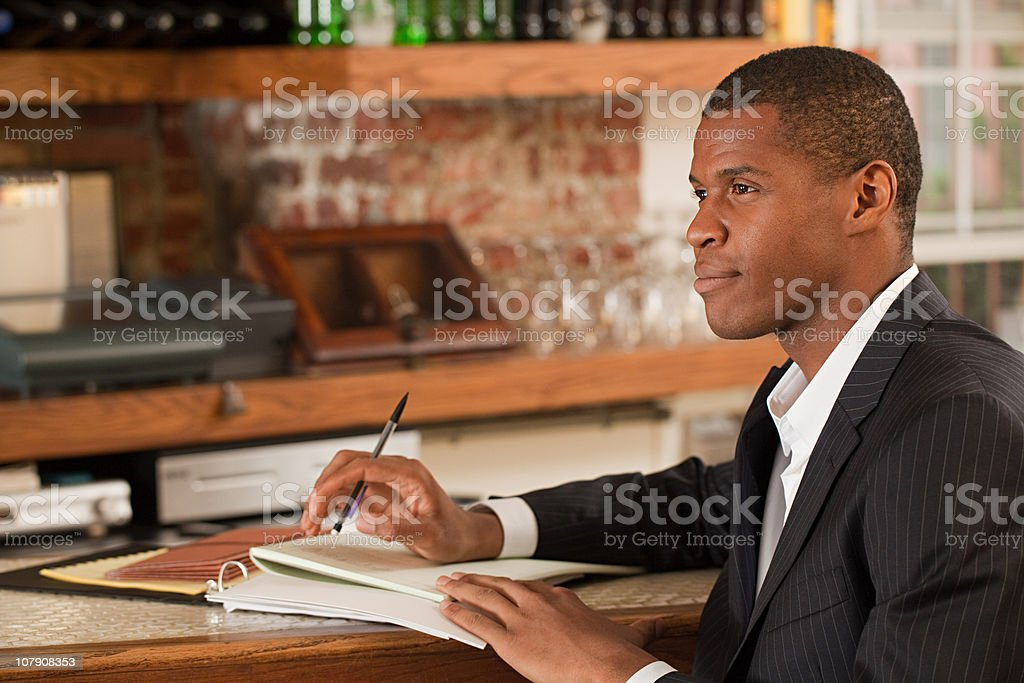 Restaurant owner looking at paperwork stock photo