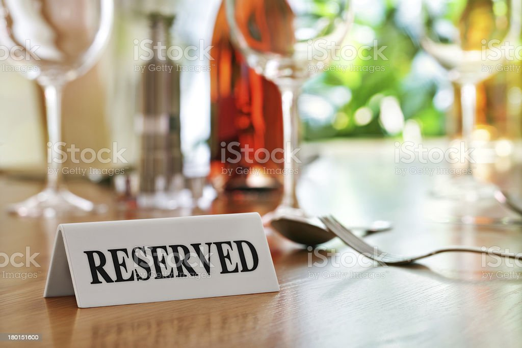 Restaurant reserved table sign stock photo