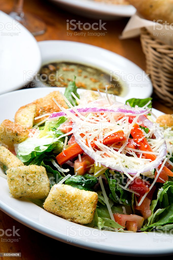 Restaurant Style House Salad With Fresh Grated Parmesan stock photo