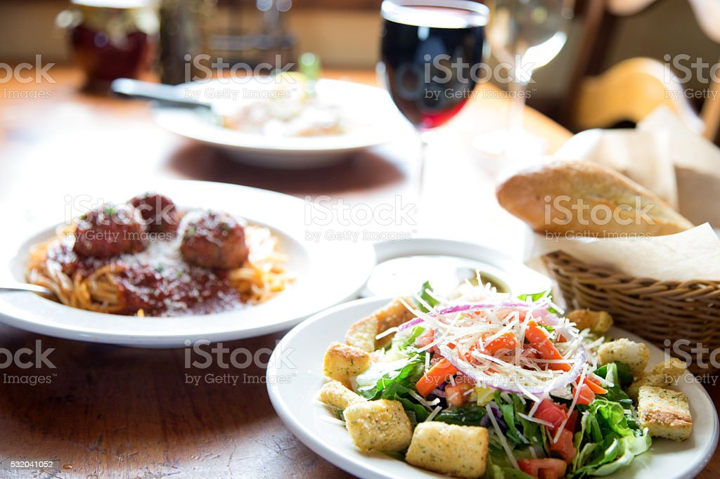 Restaurant Style House Salad With Italian Spaghetti And Meatballs stock photo