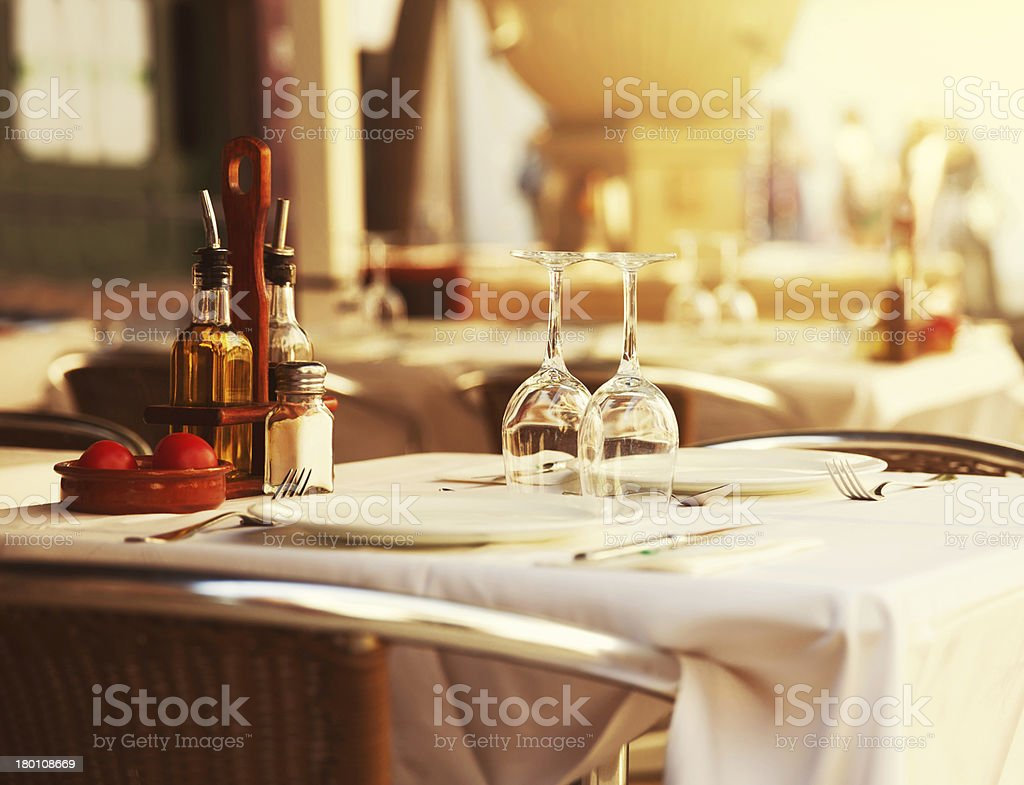 Restaurant table at sunset stock photo