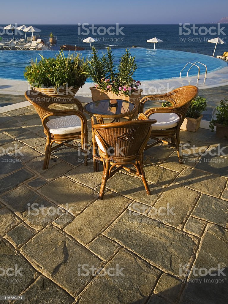 Restaurant table by the pool with sea view royalty-free stock photo