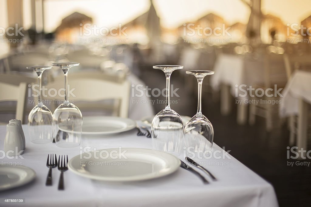 Restaurant table on the Beach at sunset stock photo