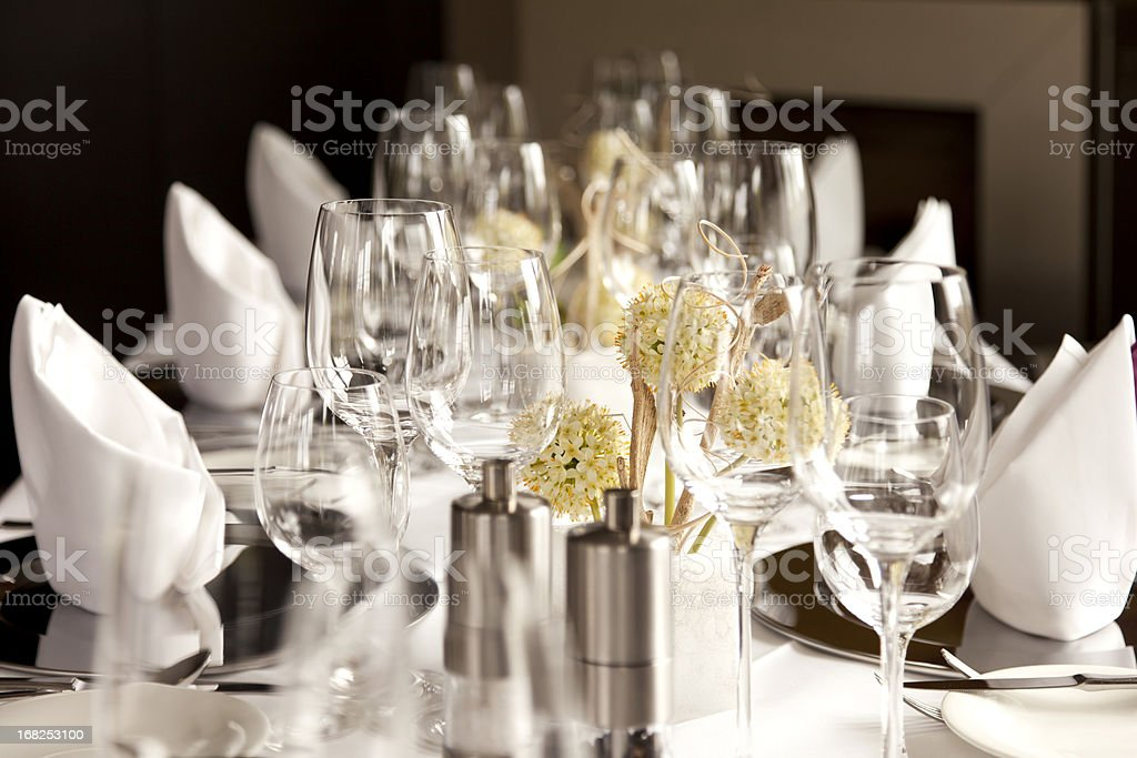 A restaurant table set at for fancy dinner royalty-free stock photo