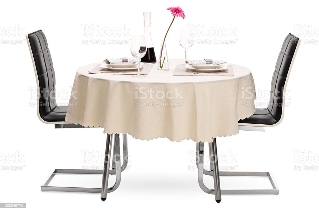 Restaurant table with a bottle of wine stock photo