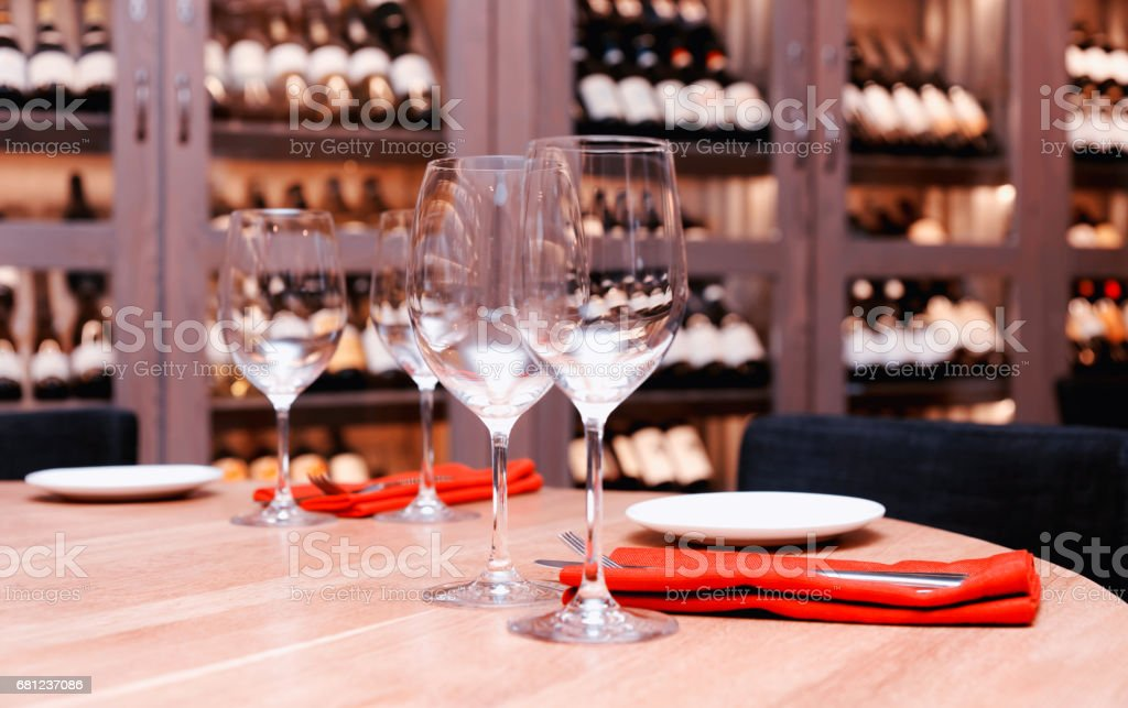 Restaurant table with wine fridge in the background, toned stock photo