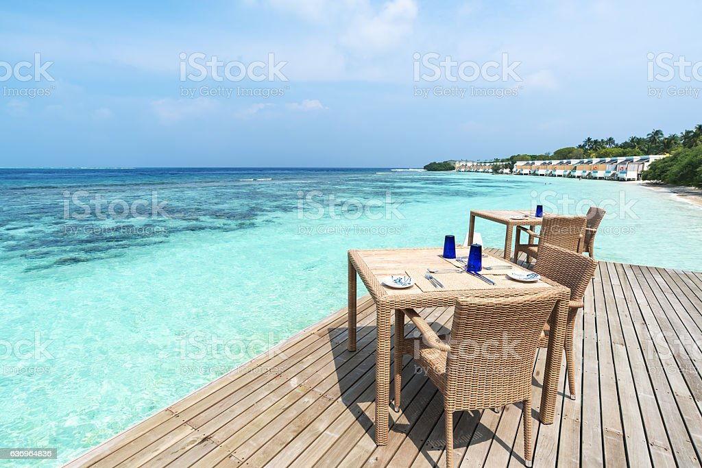 Restaurant tables and chairs on the sea view terrace stock photo