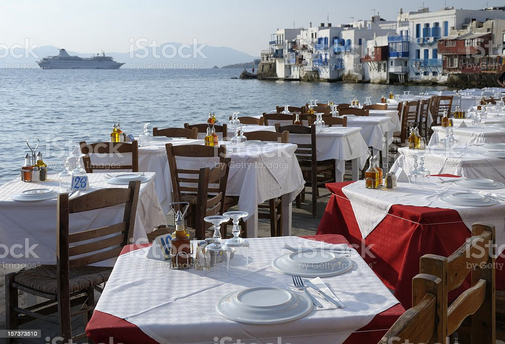 Restaurant Tables and Venetian houses in Mykonos, Greece royalty-free stock photo