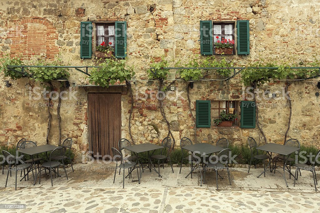 Restaurant tables in Italy stock photo