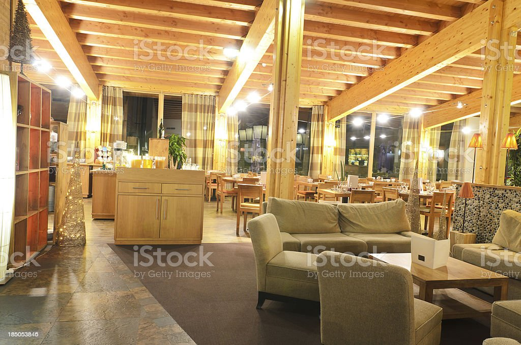 Restaurant with indoor relaxing couch art and dining area royalty-free stock photo