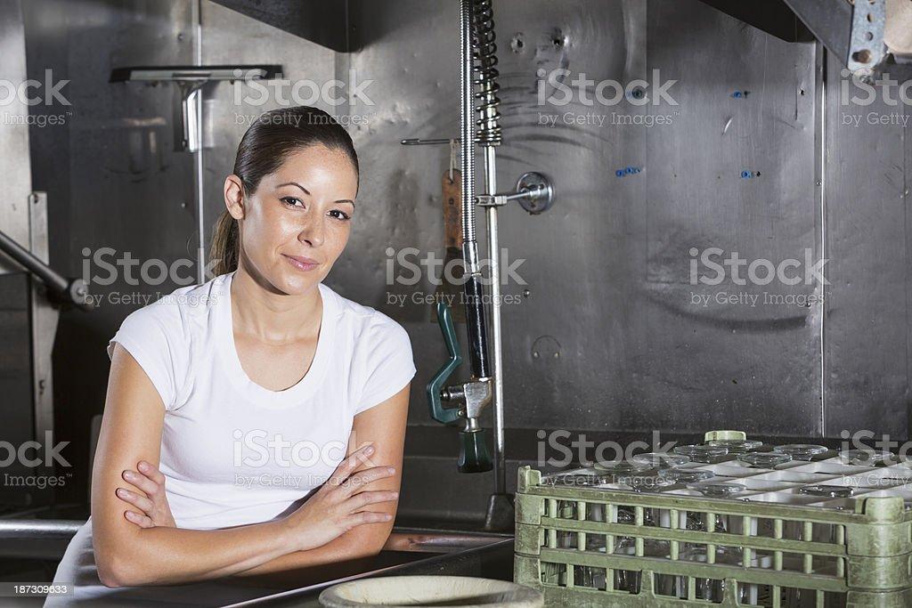 Restaurant worker in kitchen stock photo