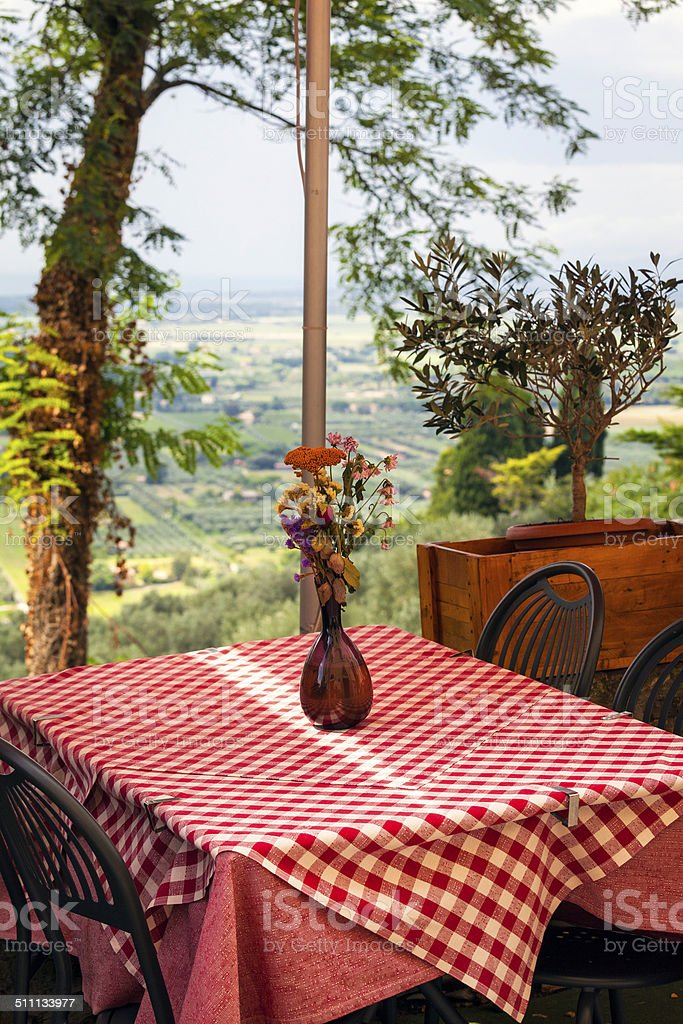Restaurant's dehor over the Tuscan coastline. color image stock photo