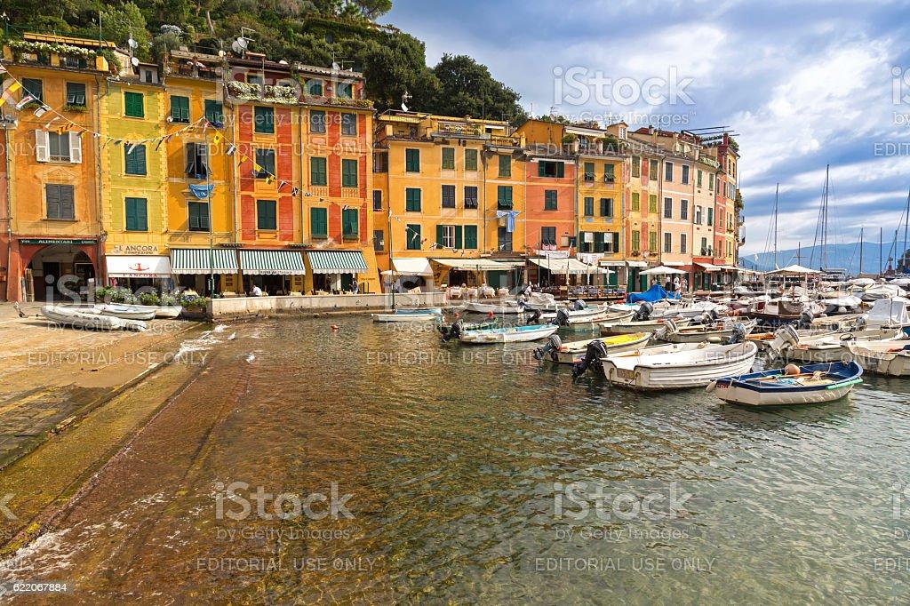 Restaurants, shops, colorful historical buildings, boats at Portofino, Italy stock photo