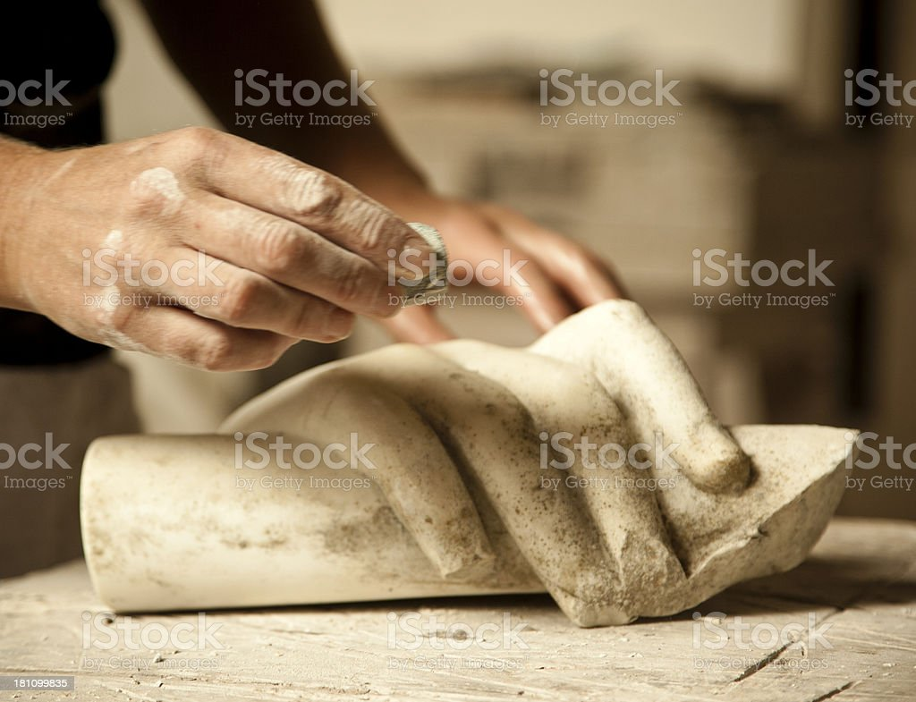 Restauring of old marble piece. stock photo