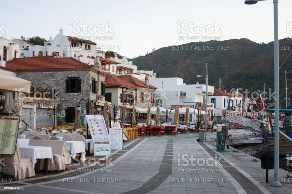Restaurtnas on sea-front street of Marmaris with mountains on stock photo