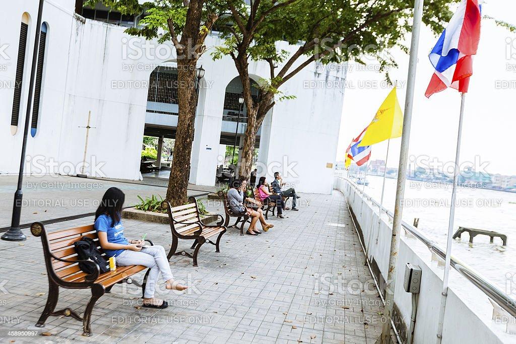 Resting along Chao Phraya river in Bangkok royalty-free stock photo