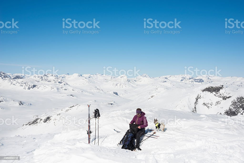 Resting at the Mount Galdeberget summit in Jotunheimen National Park stock photo