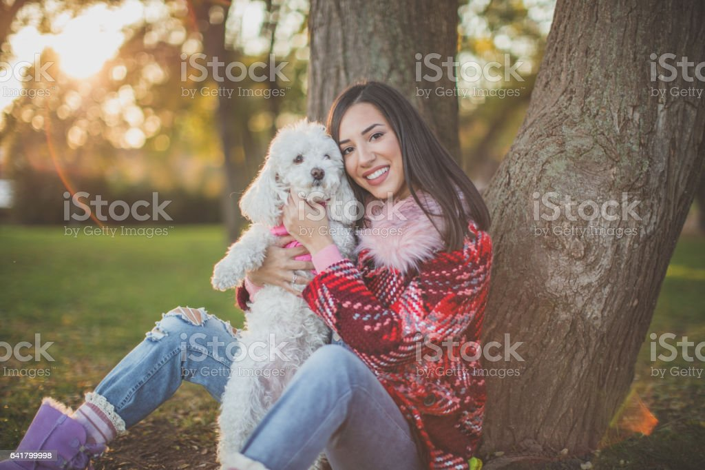 Resting by the tree in park stock photo