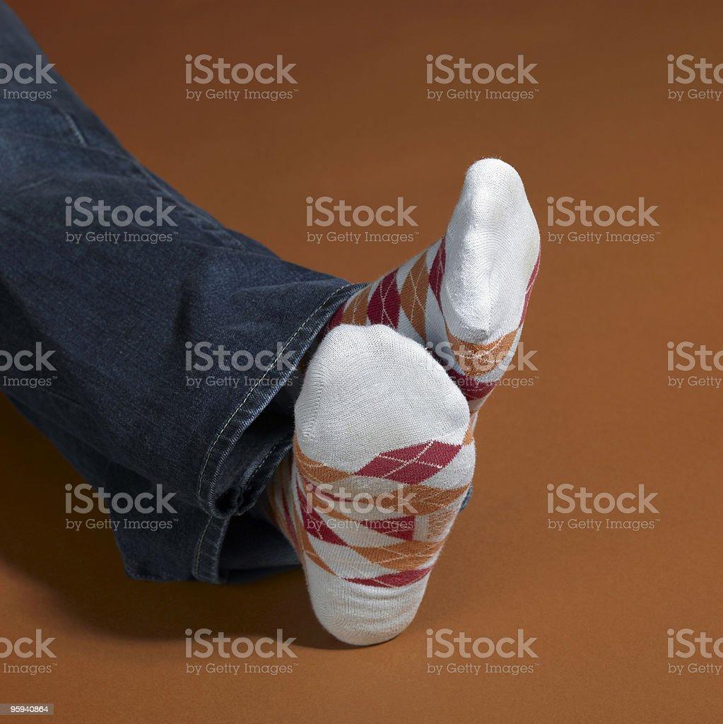 resting feet in socks stock photo