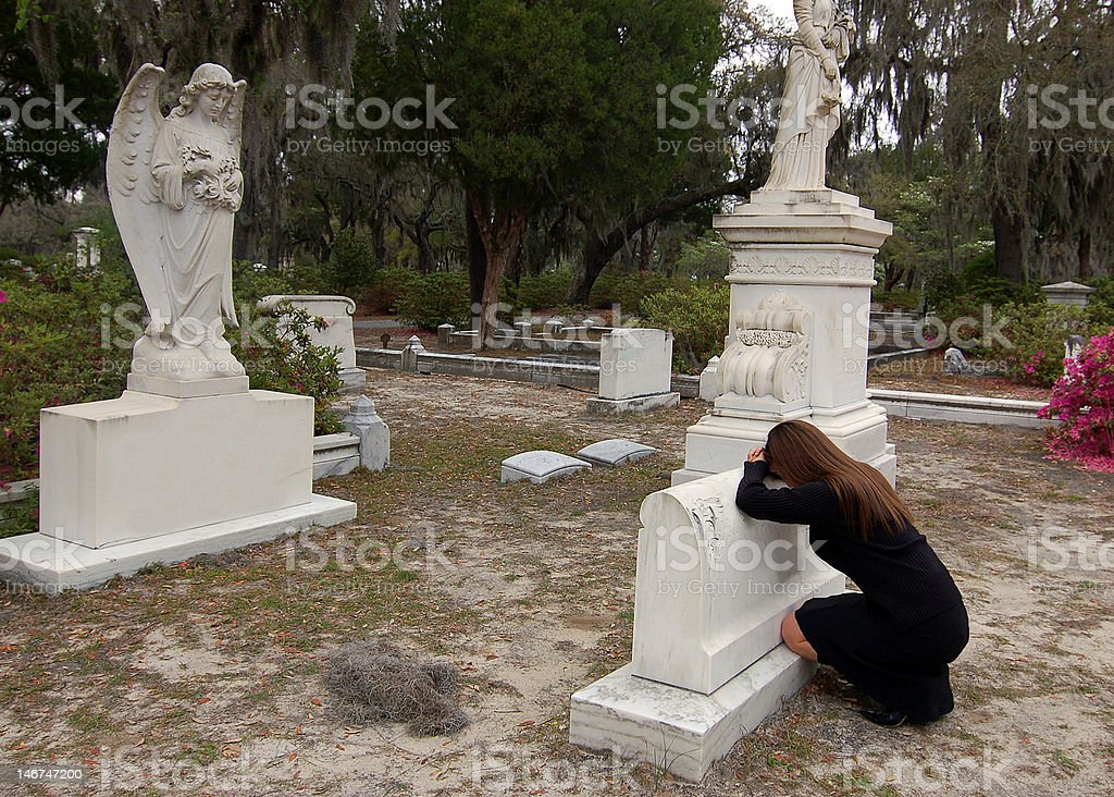 Resting Head on Tombstone royalty-free stock photo