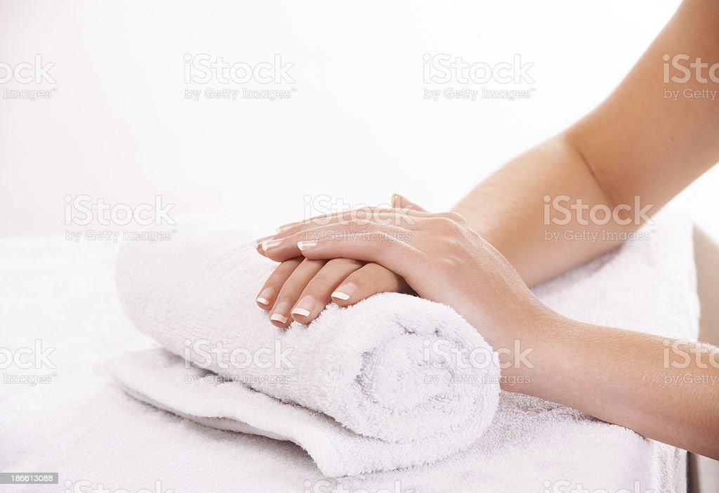 Resting her hands after a manicure royalty-free stock photo