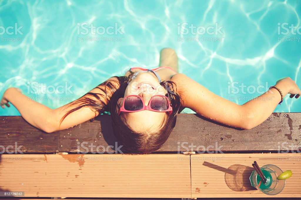 Resting in pool stock photo