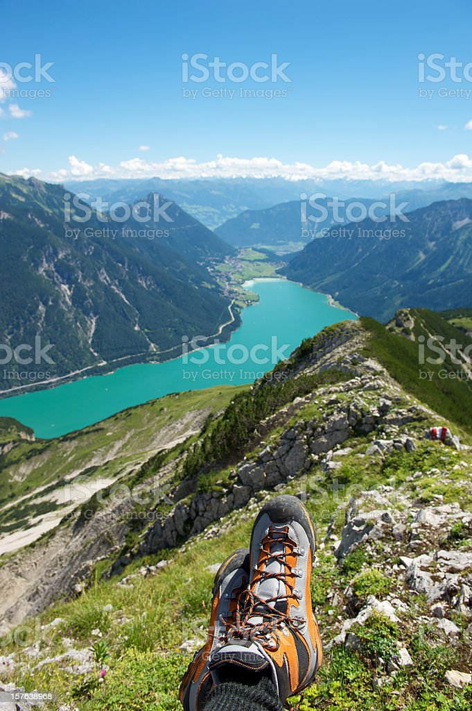Resting in the Alps - sitting on a mountain peak stock photo