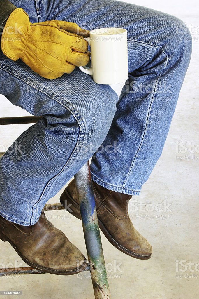 Resting in workshop. Construction worker, blue collar. Coffee break. royalty-free stock photo