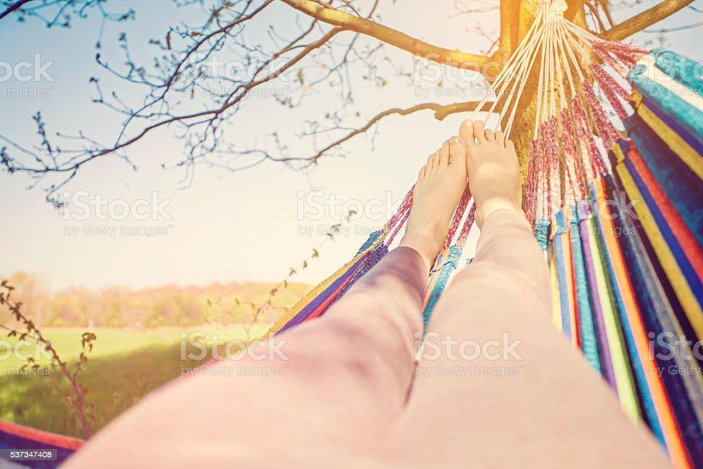 Resting legs in hammock stock photo