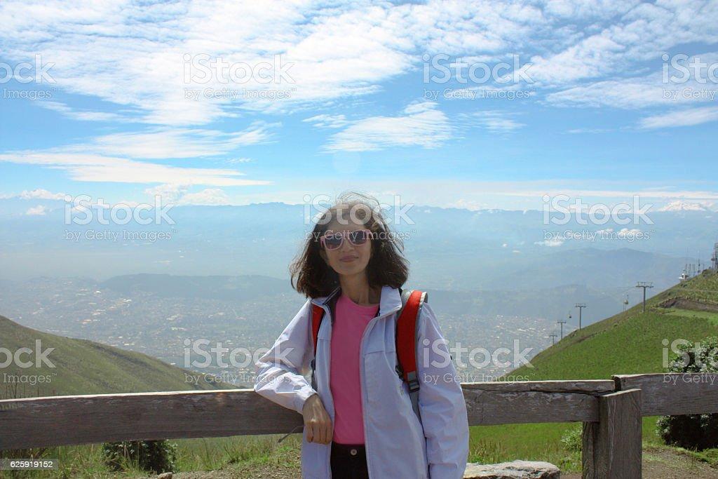 Resting mid age caucasian woman at mountain, Quito, Ecuador stock photo
