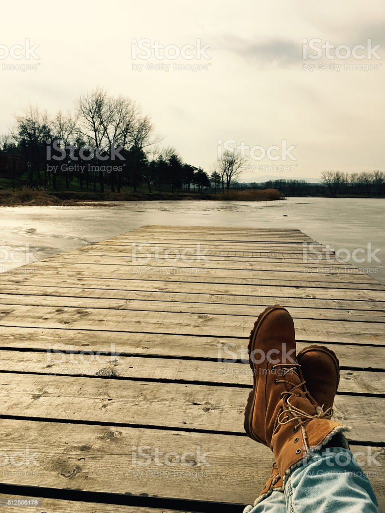 Resting on a lake dock stock photo